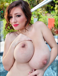 September Carrino poses nude in the hot tub
